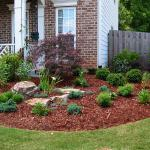 A mulched bed adds interest to the front entry of a new home.