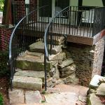 Heavy stone slabs are used to create a unique stairway to this deck.