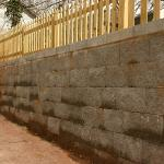 Split-face concrete block was used as an economical material for this wall.