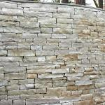 Stacked stone was used to create a dramatic curved wall standing over 6 ft tall.