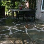 An patio was resurfaced with natural stone over existing concrete.